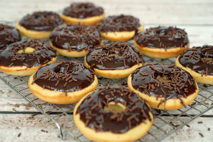 Tempting your taste buds with these gluten-free peanut butter donuts with chocolate ganache... SO easy with the liveGfree yellow cake mix from ALDI