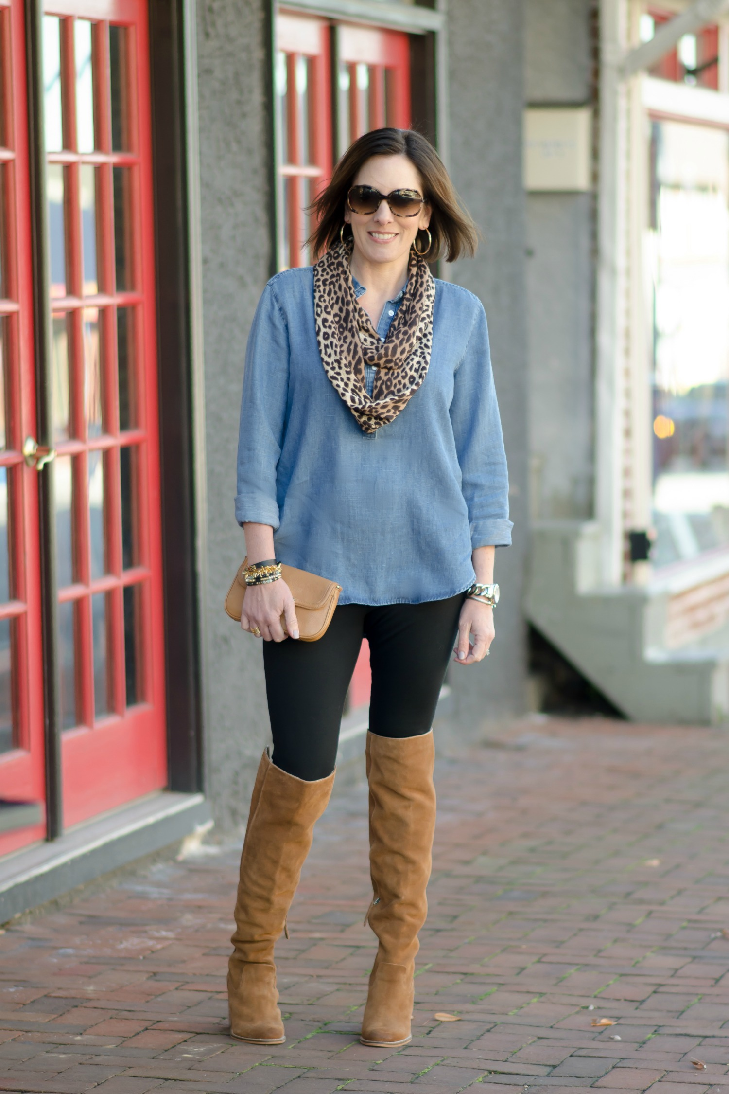 Thanksgiving Outfit Idea: Chambray Shirt and Leopard Scarf with Leggings and brown Over the Knee Boots