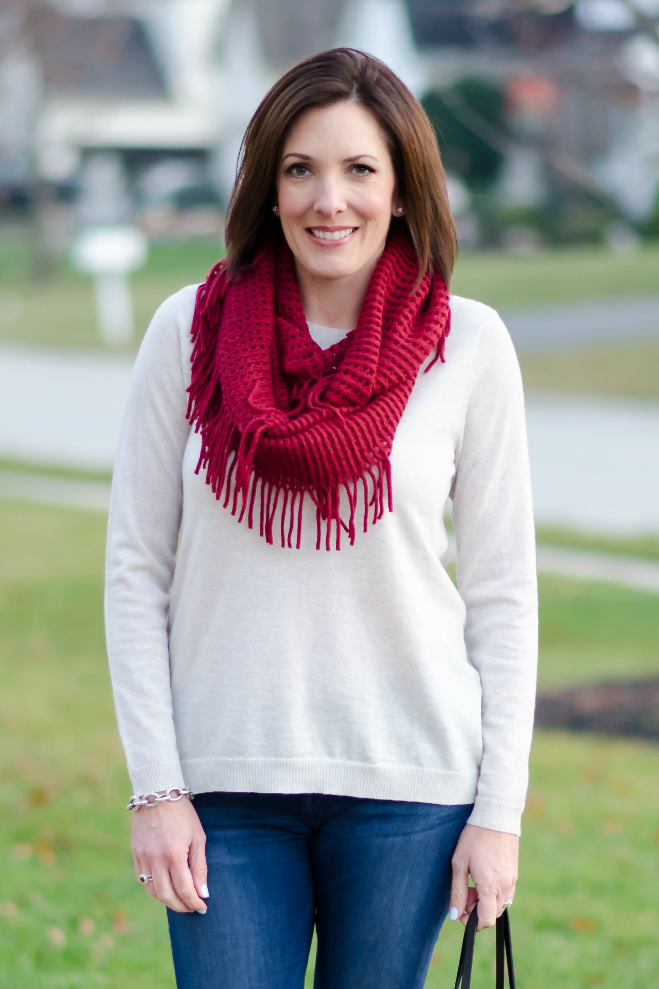 Casual Winter Outfit: Red Fringe Scarf, Relaxed Fit Oatmeal Sweater, Cropped Skinnies and Converse