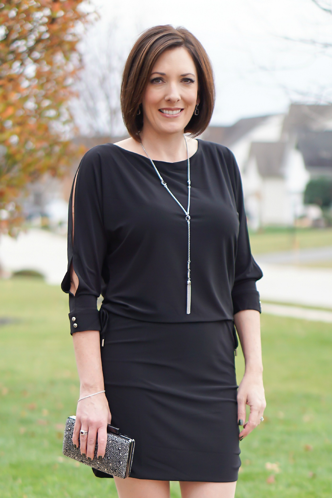 What to Wear to an Office Christmas Party: LBD with fun accessories and black suede pumps