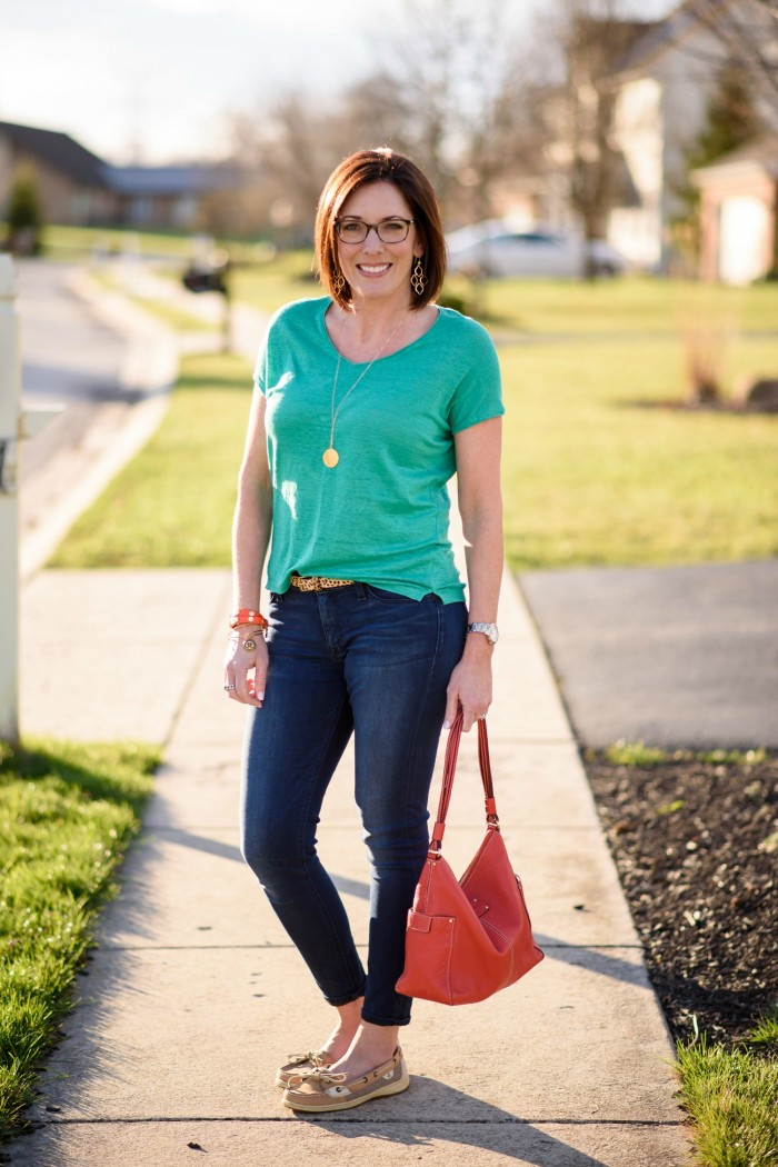 Kelly Green with Dark Denim and boat shoes... a classic spring outfit. The pop of coral and gold accessories make the outfit!