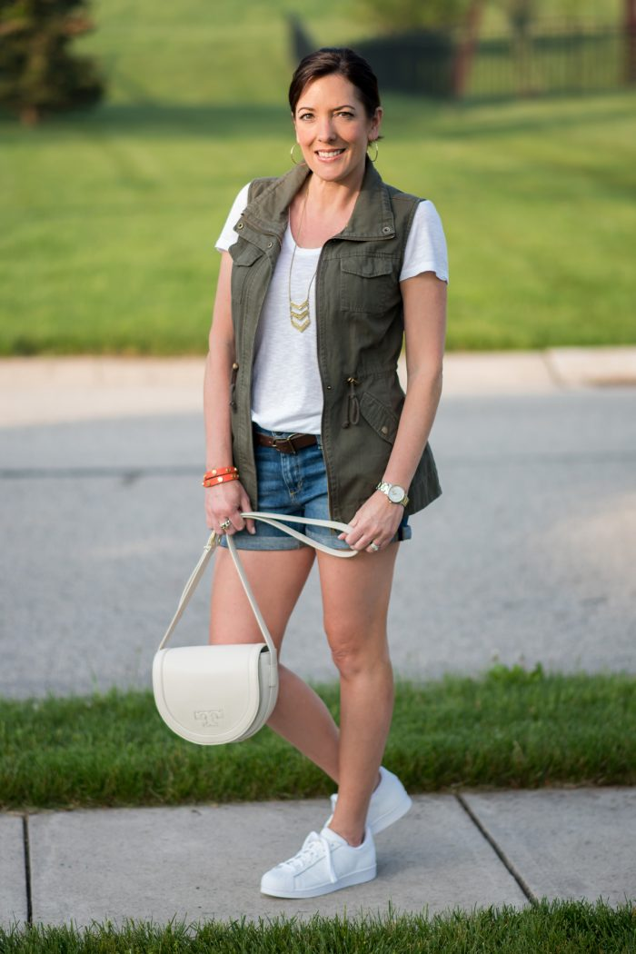 spring outfit: rolled hem denim shorts with white tee and utility vest