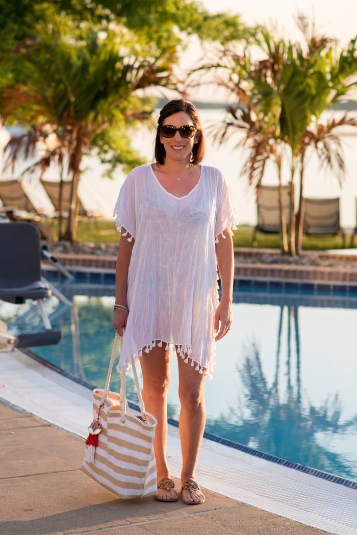 This gorgeous gauze caftan swimsuit cover-up with tassel trim is feminine and stylish. Throw it on over your bathing suit for the beach or pool.