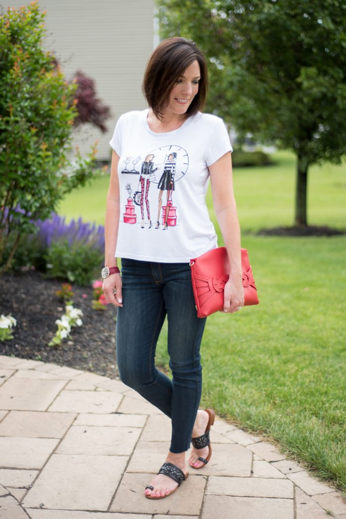 A summer outfit featuring HSN's Alice Through The Looking Glass Collection: Adventures in Wonderland Tee with Vince Camuto Leather Time Clutch & Leather Toe Ring Flat Sandals, and Roberto Pavé Station Multi-Row 7″ Cord Bracelet.