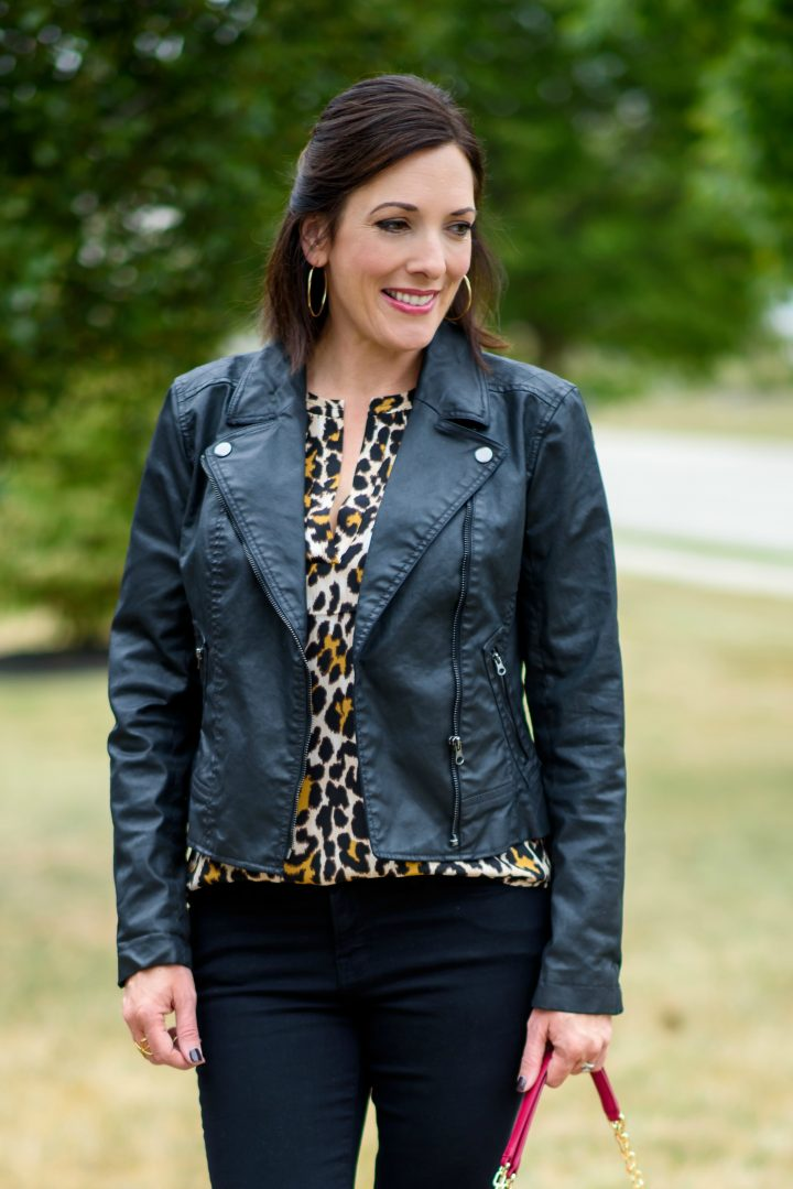 Leopard silk blouse with a moto jacket, black jeans, and a pop of pink!