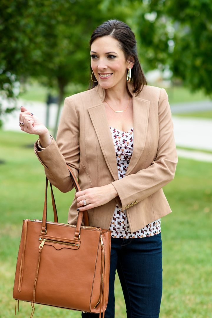 How can you not love a chic blazer with jeans and an edgy tote? This printed blouse in fall colors is the perfect pop of interest in this classic look.