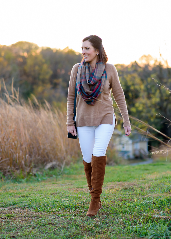 Another great way to style white jeans for fall -- camel cashmere sweater with white skinnies, chestnut over-the-knee boots, and a plaid infinity scarf.