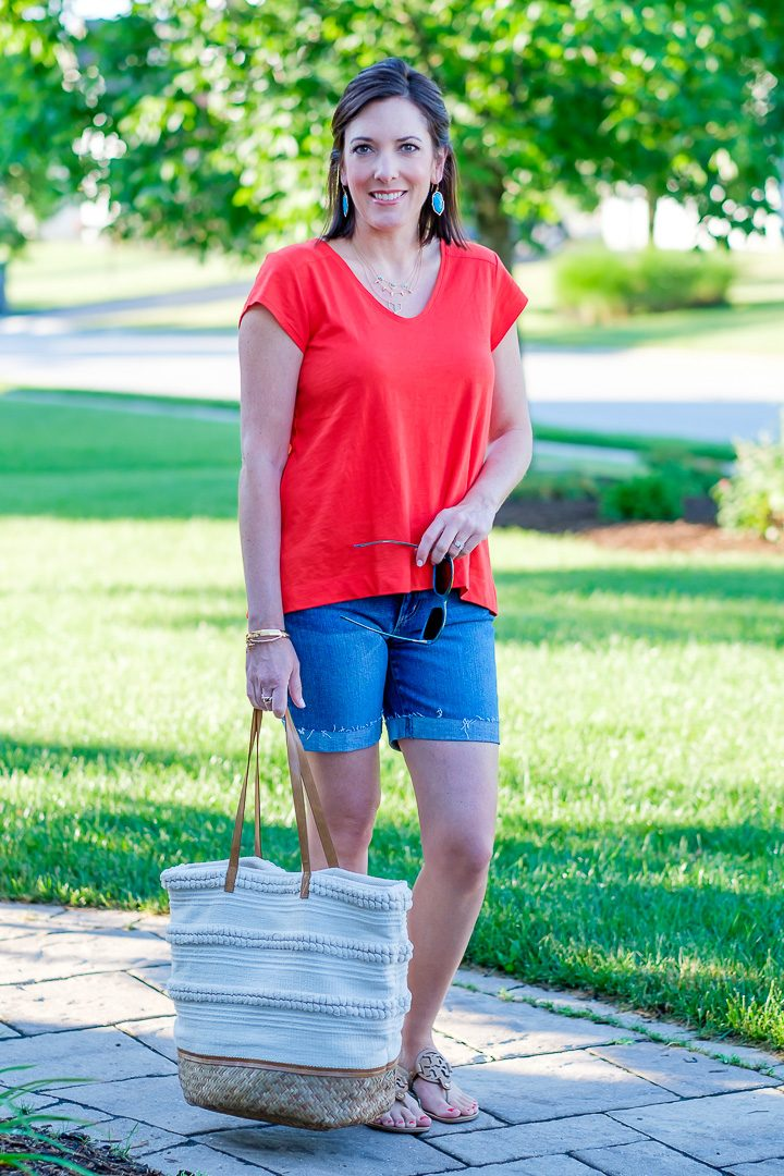 A casual summer swing top and denim shorts outfit featuring Loft vintage soft swing tee in red tamale with 6-inch denim roll shorts and Tory Burch Miller Sandals.