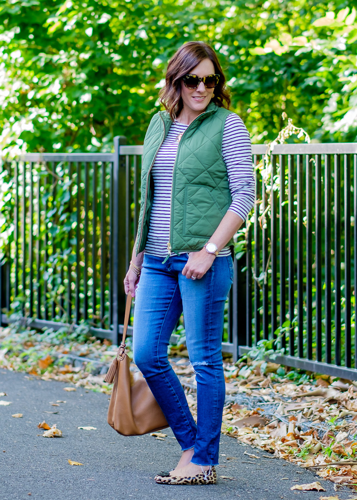 Jo-Lynne Shane wearing a classic quilted puffer vest outfit with a striped tee & leopard flats for Day 7 of 26 Days of Fall Fashion